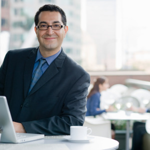 Smiling business man with computer