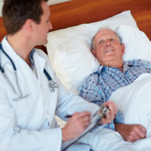 Elderly patient smiling with doctor